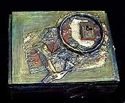 Pringle's lid as part of assemblage on art shrine